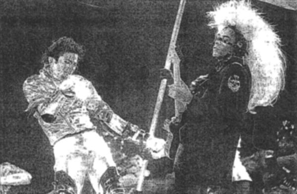 Long ago it seems-  Greg Howe on stage with Michael Jackson ( photo is from an undated press clipping)