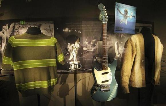 "Rarely displayed memorabilia including iconic clothing and musical instruments of the late Kurt Cobain were on display at the ""Nirvana: Taking Punk to the Masses"" exhibition in Seattle."