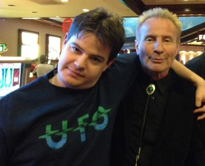 Review author Taylor Carlson (left) with UFO vocalist Phil Mogg (right). Taken at UFO's Boulder Station concert, December 2012.