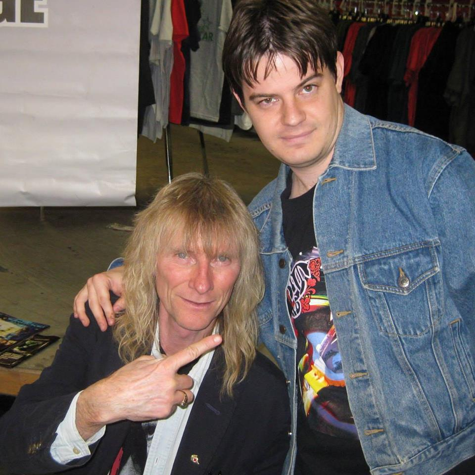 Author Taylor Carlson (right) with Kix vocalist Steve Whiteman (left) at the Zia signing.