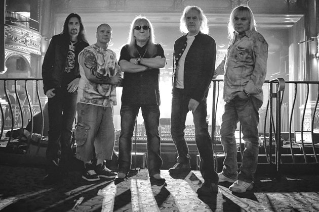 Press photo of the current lineup of the band, from their official website. From left to right: Davey Rimmer (bass), Russell Gilbrook (drums), Mick Box (guitar), Phil Lanzon (keyboards), and Bernie Shaw (vocals).