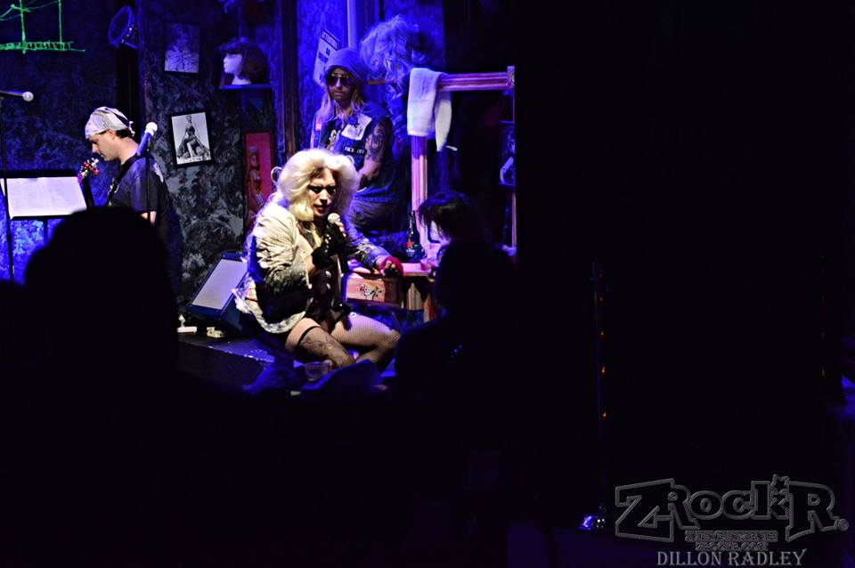 Hedwig interacting with fans on the side of the stage.