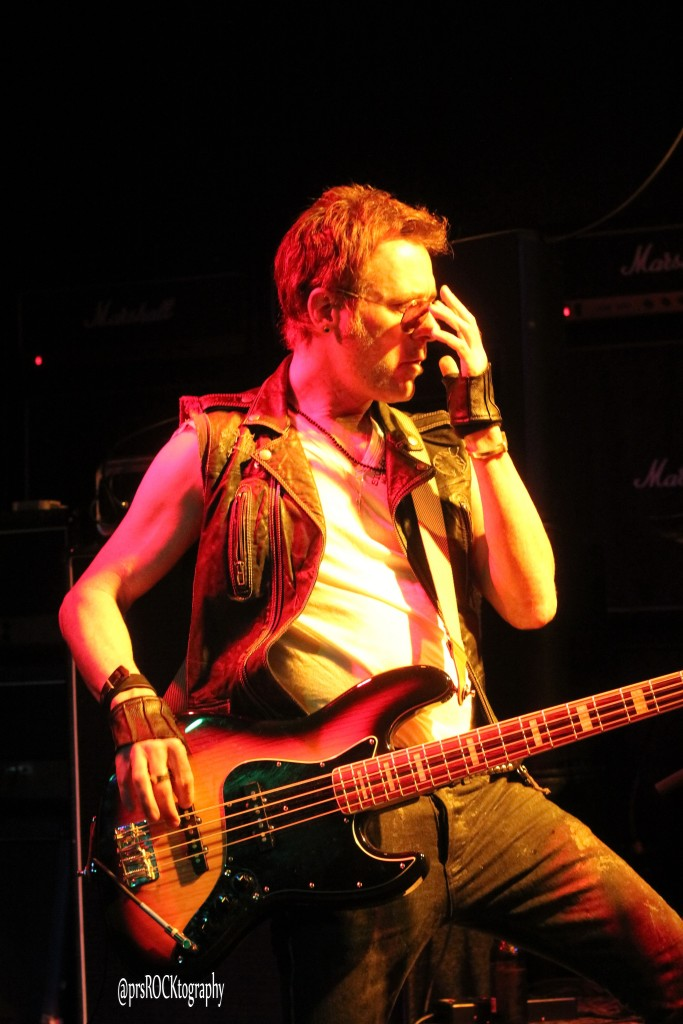 Former Mickey Ratt/Rough Cutt bassist Matt Thorne, rocking on stage with Pearcy!