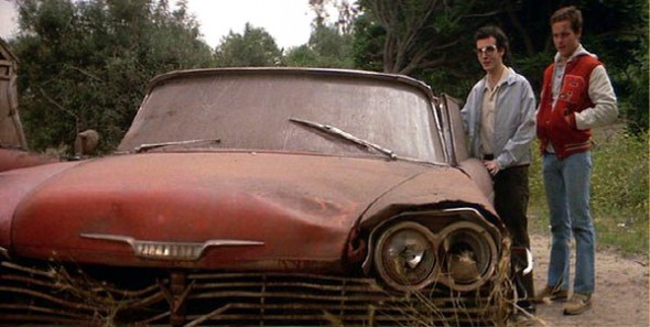 In the film, Arnie Cunningham (left, portrayed by Keith Gordon) becomes obsessed with the titular car, and is radically changed by his obsession.