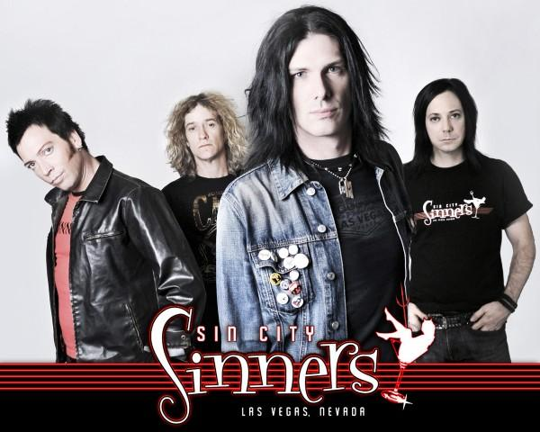 "The ""classic"" version of the band that appeared on the first three CDs. From left to right - Doc Ellis, Rob Cournoyer, Todd Kerns, Brent Muscat"