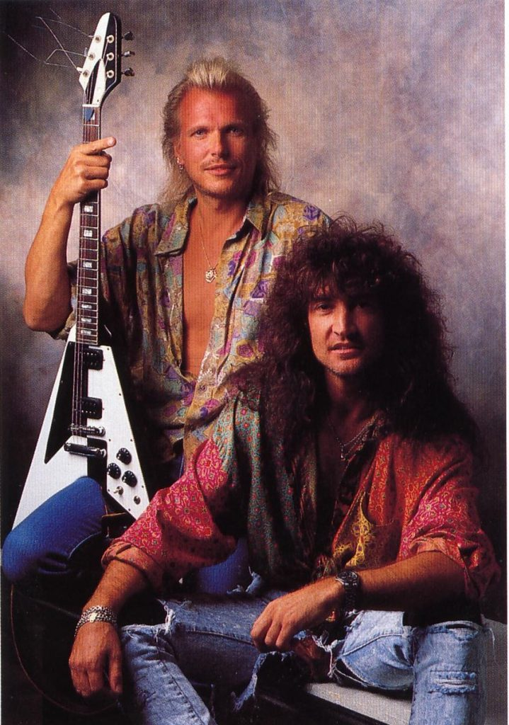 Vintage image of Robin McAuley and Michael Schenker.